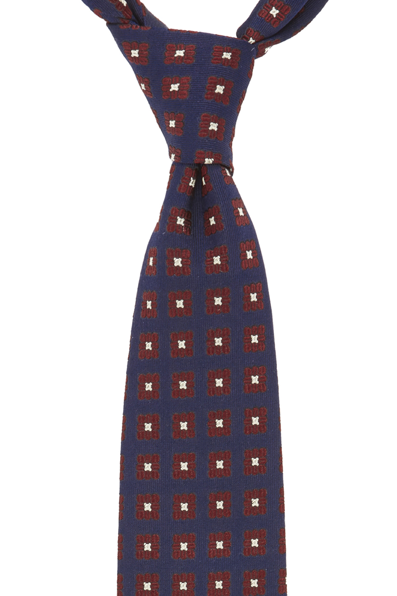 For an example, If you were buying a tie for your brother who happens to wear a navy suit and white shirt to work, then go for a blue tie, which has a different colour within the pattern like the Rupert tie. The additional colour will create a contrast between shirt and suit, which will create distinct visual interest.
