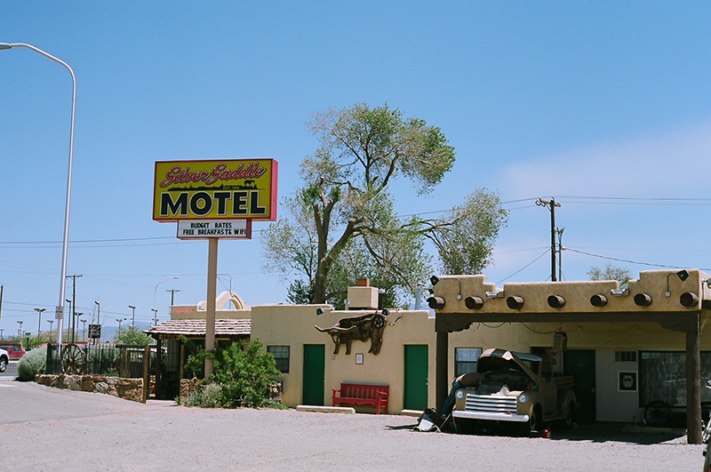 One of the best parts about road tripping through the Southwest is the motels. They have funny kitchy names and incredible signs. This scene was too perfect with the old man working on his vintage Chevy.
