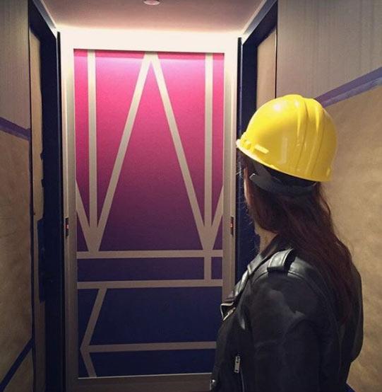 Overseeing the installation of corridor artworks.