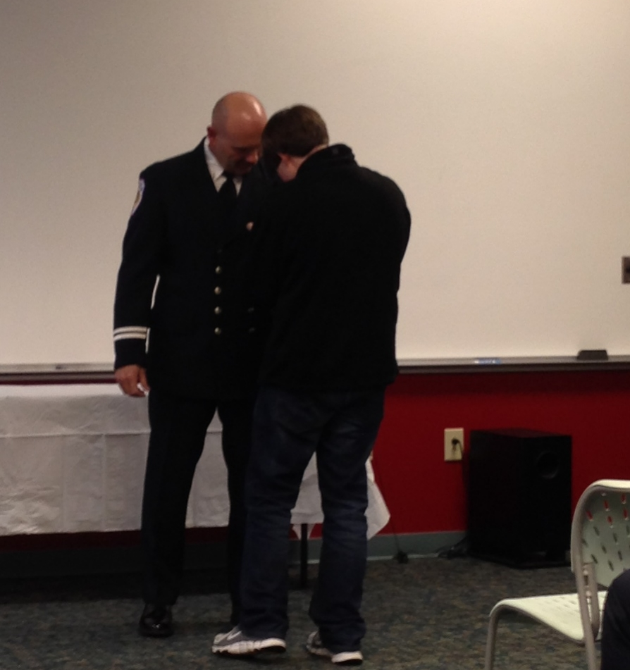 Spencer Brown is pinning his father, Lt. Charlie Brown, for his promotion to Captain