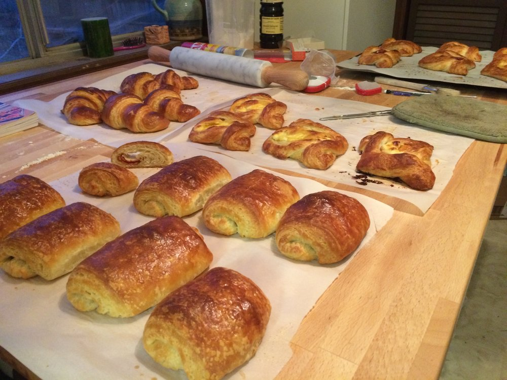 Assorted pastries using laminated dough: classic croissants, chocolate croissants, danish with cheese and jam