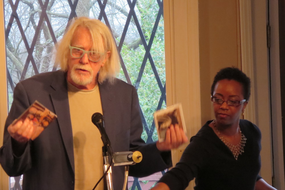 Documentary filmmaker George King showing the Lonnie Holley CD's that come with various pledge levels.