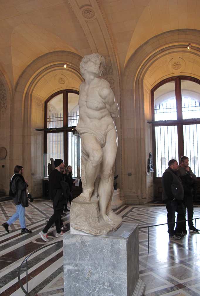The one artist I admired more than any other growing up was Michelangelo. This is one of two marble sculptures they have in their collection at the Louvre.