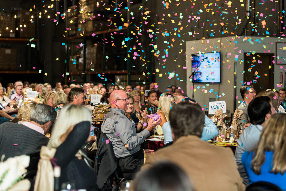 Every time an auction item was bid above $2,000, confetti was shot out of an air cannon. This fun antic helped keep the mood exciting, the prices high, and the guests laughing.