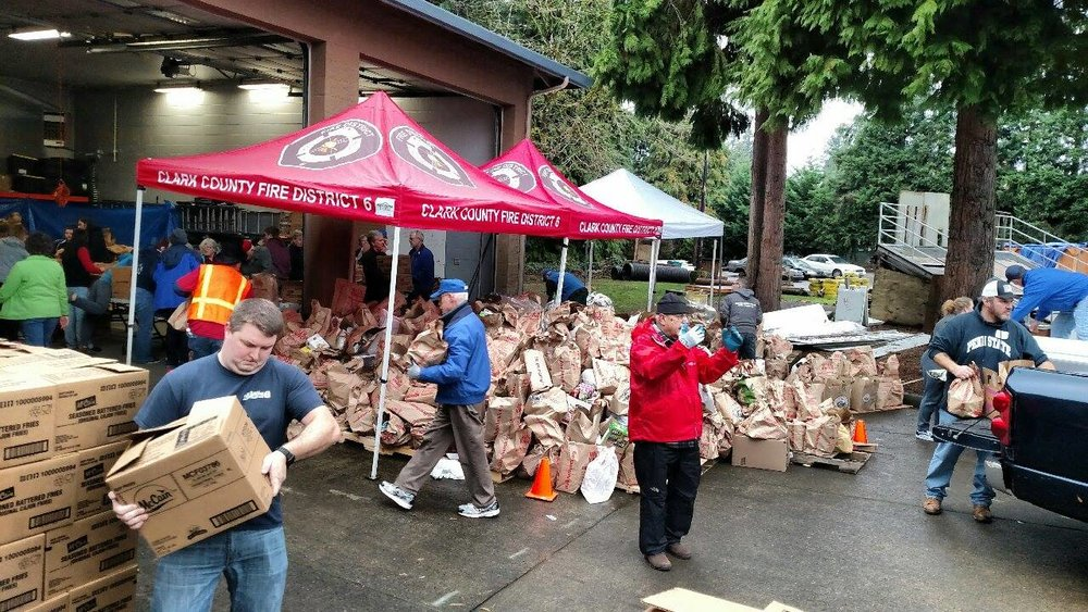 Volunteers at Fire District 6 in Hazel Dell were among the thousands across the county who helped direct traffic, unload donations, and box food.