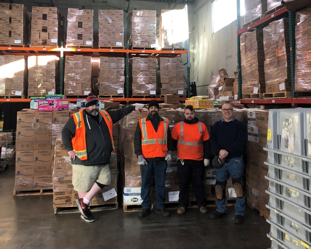 After unloading ten semi-truck trailers full of food from Walk 7 Knock, boxes were stacked three stories high in Clark County Food Bank's warehouse.