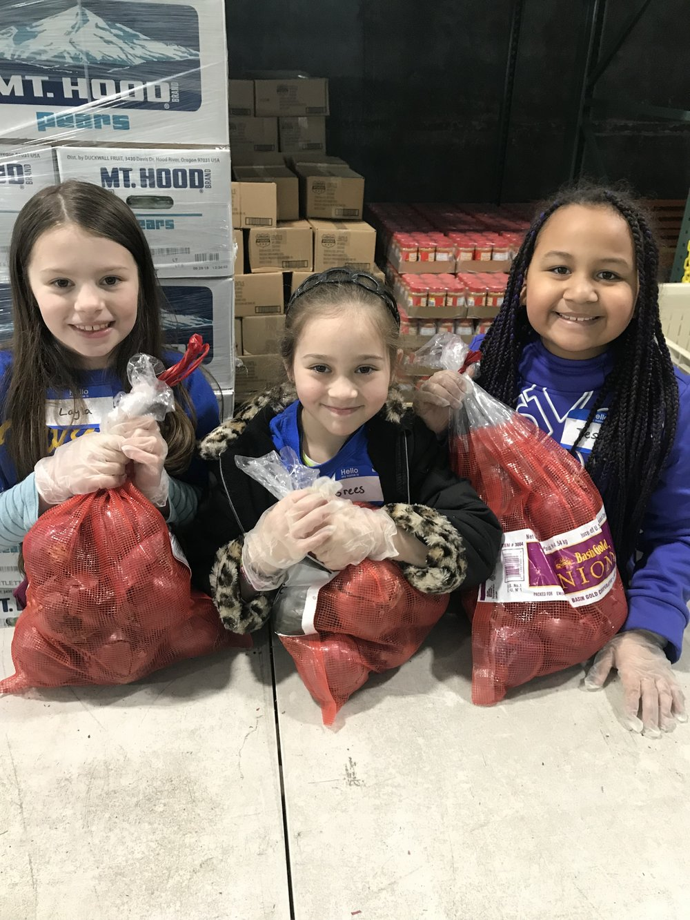 During the visit, second graders weighed their food donations and packed food boxes for families in our community.