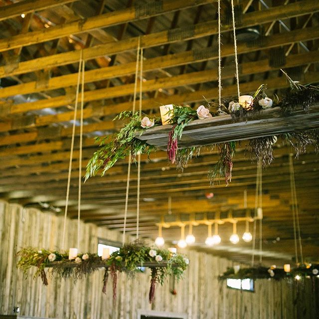 Hanging wooden plank chandeliers with dripping floral and greenery made for the most intimate setting at @blueskyutah 📷: @christineolson