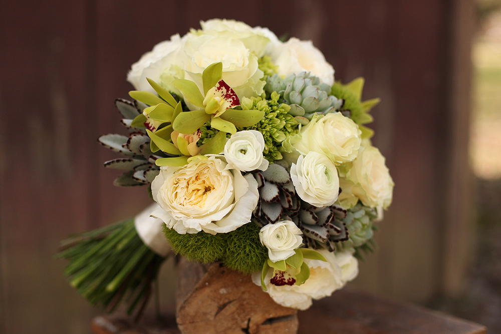 Woodland inspired bridal bouquet by Floral Verde LLC in Cincinnati, Ohio, with succulents, white ranunculus, Patience garden roses, Mondial roses, mini green hydrangea, green mini cymbidium orchids, Green Trick dianthus, Jade trachellium, Haworthia fasciata, Echeveria 'Painted Lady' and Kalanchoe tomentosa.