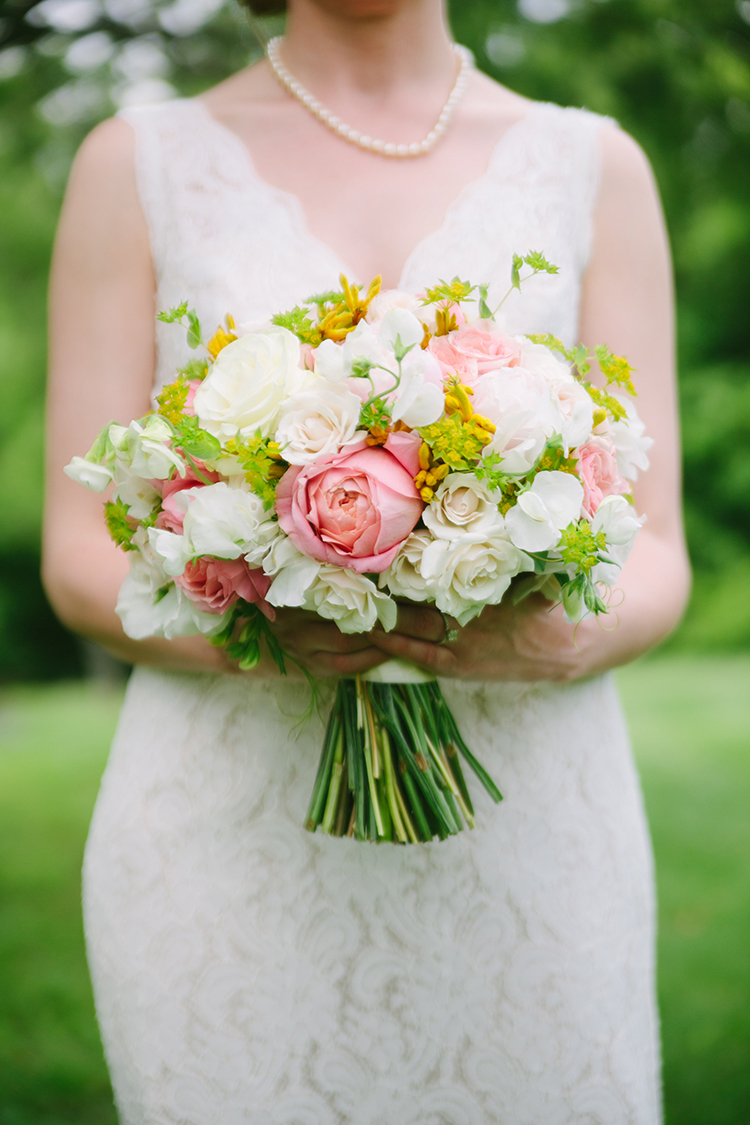 Bridal bouquet with Romantic Antike and Keira garden roses, spray roses, blush peonies, white sweet peas, Mondial roses, bupleurum and yellow kangaroo paws. By Cincinnati wedding florist Floral Verde.