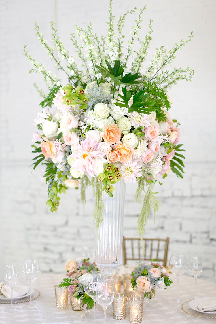Tall tropical centerpiece, by Cincinnati wedding florist Floral Verde.
