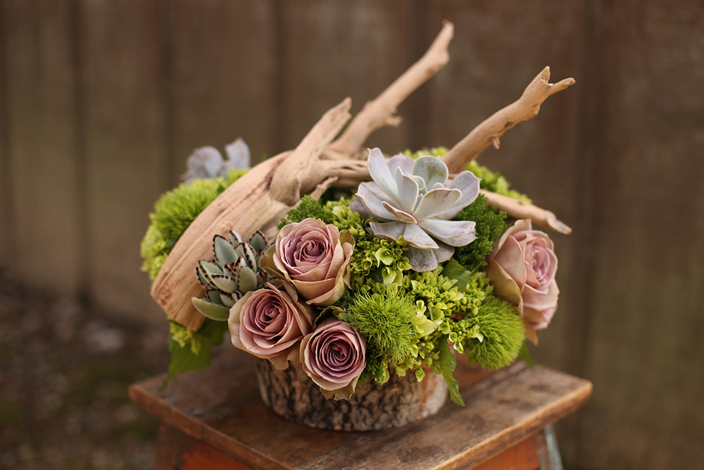 Woodland centerpieces at Krippendorf Lodge, by Cincinnati wedding florist Floral Verde LLC. Centerpiece contains ghost wood branches, succulents, Amnesia roses, Echeveria lilacina, Kalanchoe tomentosa, green hydrangea, Green Trick dianthus and green trachelium in a birch bark pot.