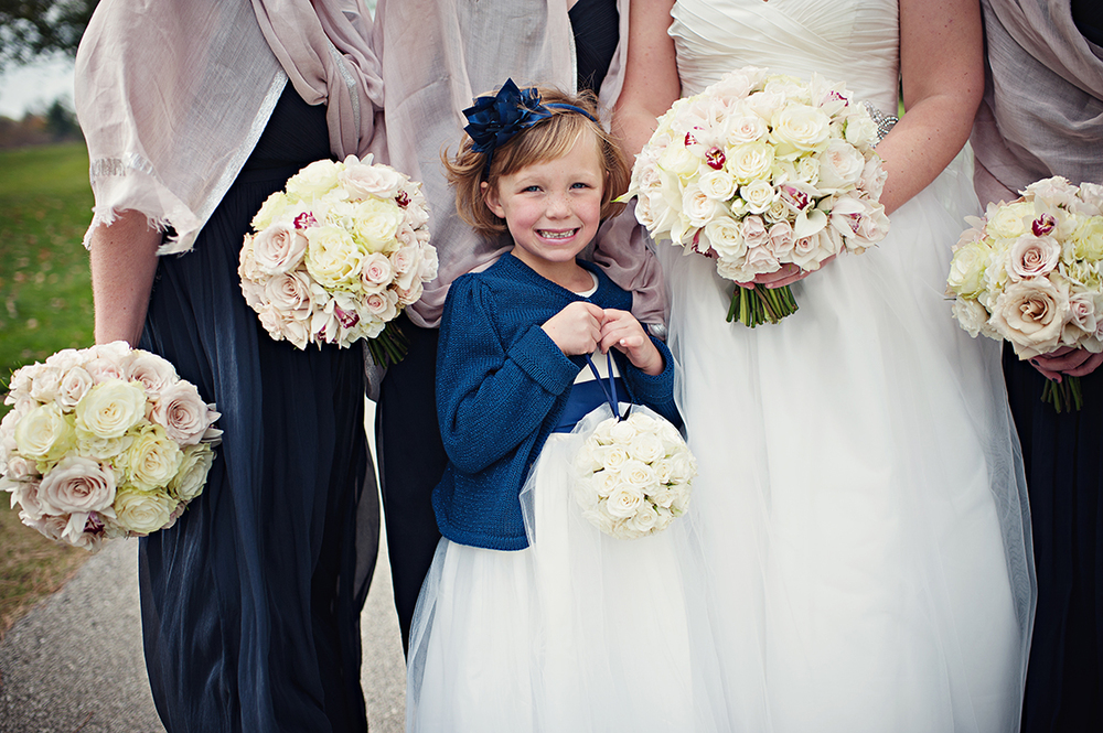 Flower girl pomander with Snow Flake spray roses. Flowers by Cincinnati wedding florist Floral Verde LLC. Image by  Leah Robbins Photography .