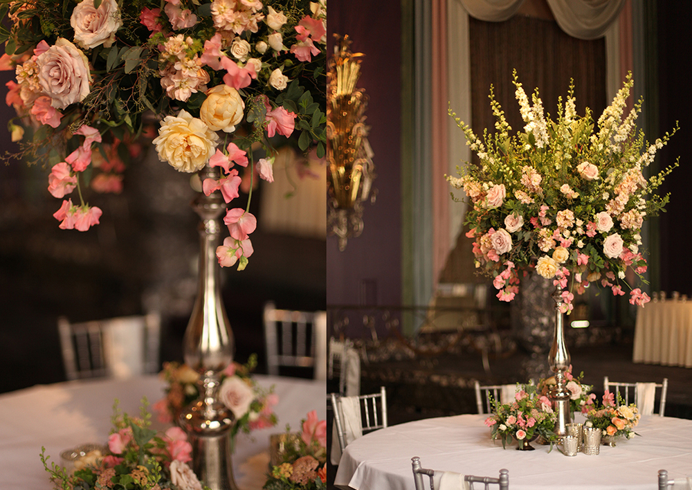 Elevated garden centerpiece in the Continental Room at the Hilton Netherland Plaza Hotel, by Cincinnati wedding florist Floral Verde LLC. Centerpiece contains coral sweet peas, apple blossom yarrow, Ambridge garden roses, Chablis spray roses, apricot stock, Quicksand roses, White Majolica spray roses, white larkspur, baptisa, Bailey's compact viburnum, bupleurum, gunnii eucalyptus and seeded eucalyptus.