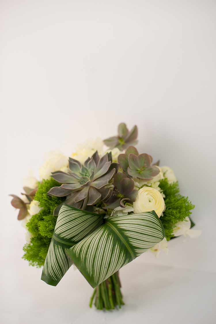 Bridal bouquet with succulents, hellebores, calathea, jade trachelium, green hydrangea, Antique Romantica garden roses, ivory ranunculus and sweet peas. By Cincinnati wedding florist Floral Verde.