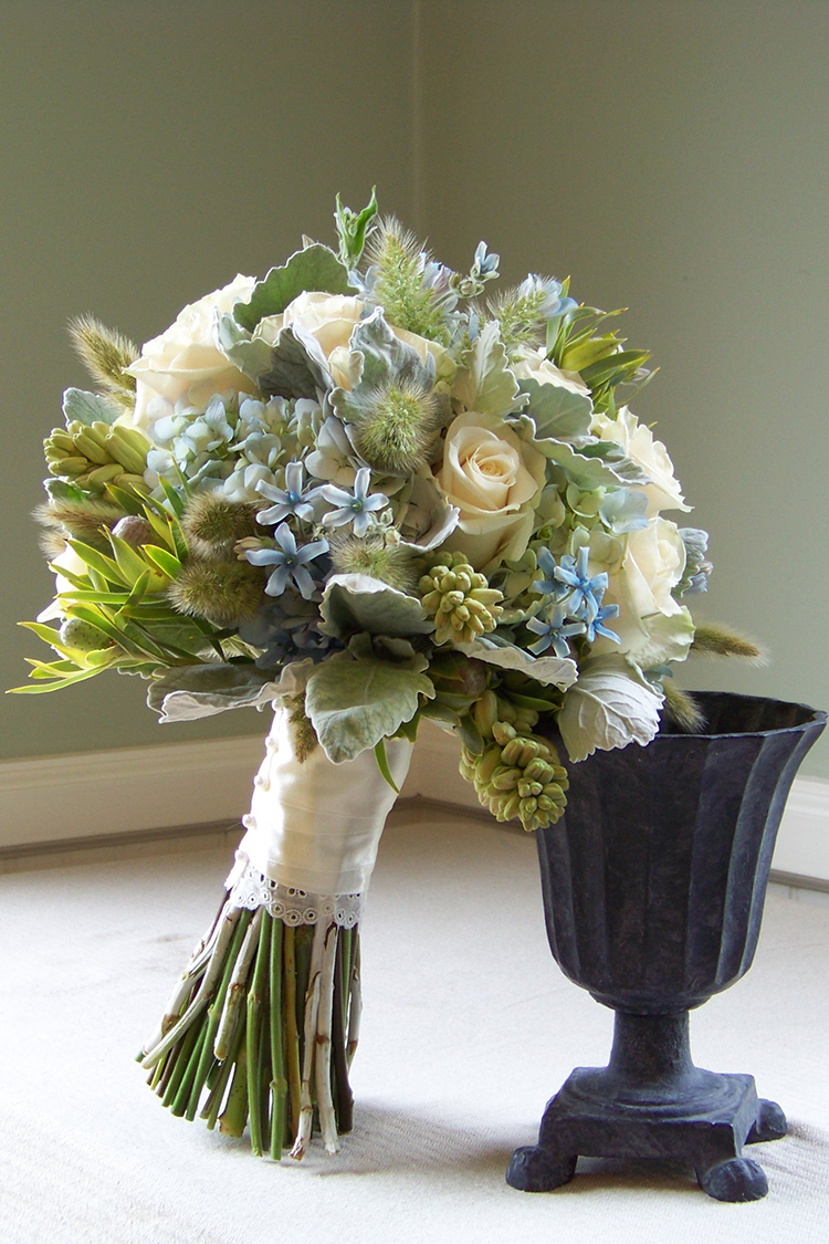 Blue, green and ivory bridal bouquet with tweedia, hydrangea, dusty miller, Vendela roses, bunny tail grass, tuberoses and Leucadendron 'Pisa'. By Cincinnati wedding florist Floral Verde LLC.