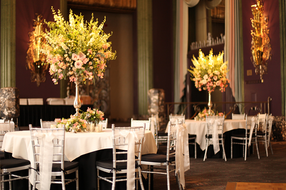 Elevated garden centerpieces in the Continental Room at the Hilton Netherland Plaza Hotel, by Cincinnati wedding florist Floral Verde.