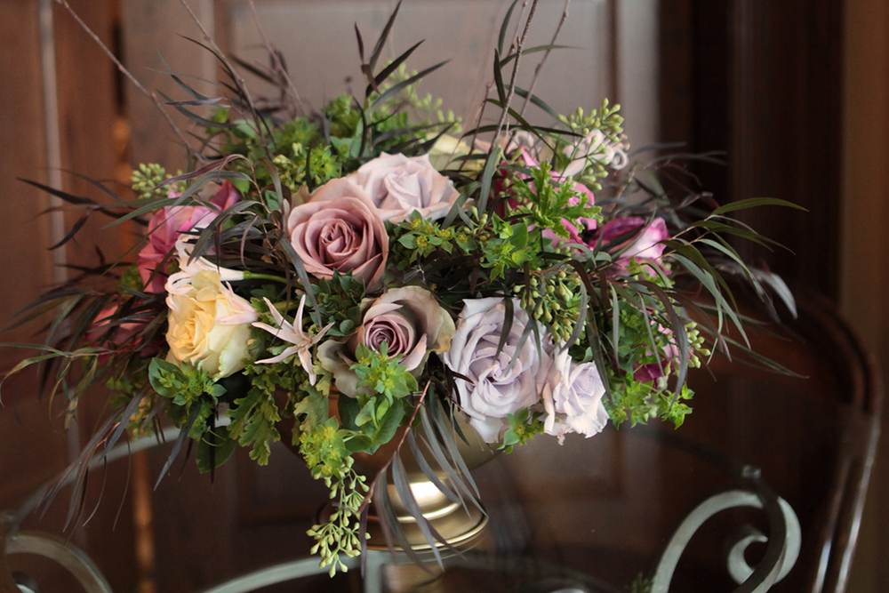 Garden centerpieces with Amnesia roses, Maritim roses, Cream Prophyta roses, Little Silver spray roses, blush nerine lilies, agonis, bupleurum, seeded eucalyptus and birch branches in a gold footed bowl, by Cincinnati wedding florist Floral Verde LLC.