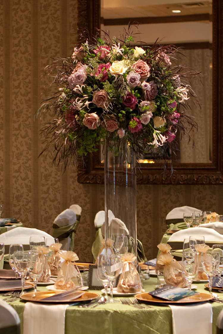 Tall centerpieces with Amnesia roses, Maritim roses, Cream Prophyta roses, Little Silver spray roses, blush nerine lilies, agonis, bupleurum, and seeded eucalyptus, by Cincinnati wedding florist Floral Verde LLC.