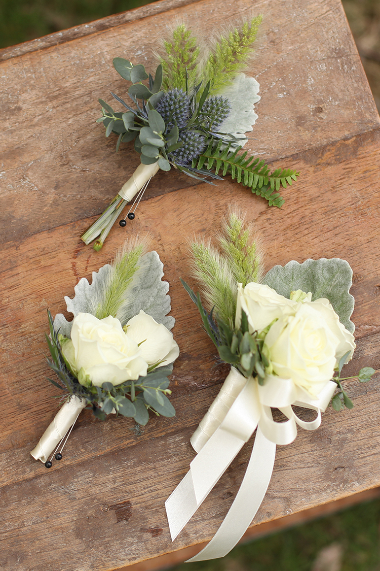 Boutonnieres and corsages with Snow Flake spray roses, eryngium, dusty miller, gunnii eucalyptus and bunny tail grass. By Cincinnati wedding florist Floral Verde.