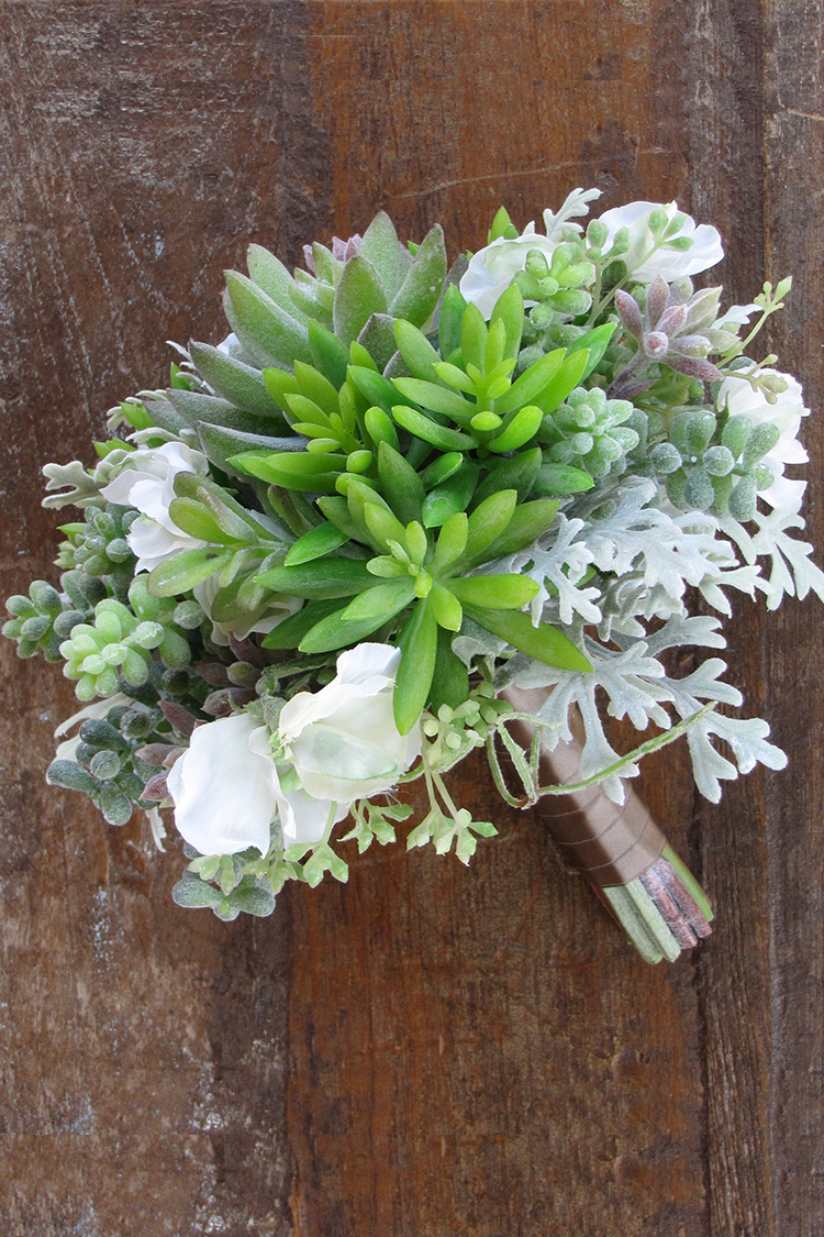 Silk bridal bouquet with white sweet peas, echeveria, sedum, donkey tail, seeded eucalyptus, and dusty miller by Floral Verde LLC in Cincinnati, Ohio.