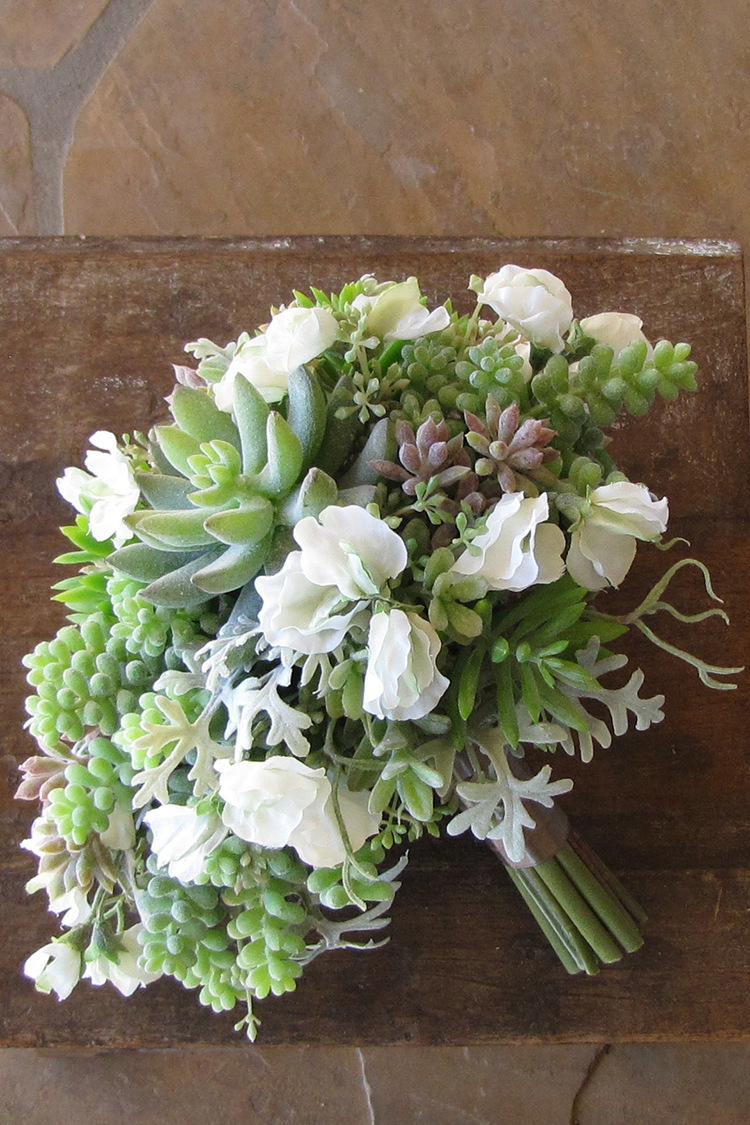 Silk cascading bridal bouquet with white sweet peas, echeveria, sedum, donkey tail, seeded eucalyptus, and dusty miller by Floral Verde LLC in Cincinnati, Ohio.