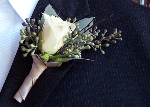 boutonniere with one Cream Prophyta rose, seeded eucalyptus, bamboo sprigs, and oatmeal satin ribbon