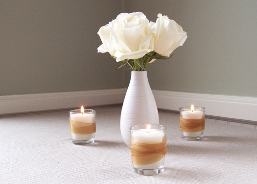 votives customized with gold organza ribbon