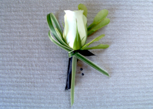 fathers' boutonnieres made up of an Akito rose, boxelder seeds and variegated lily grass