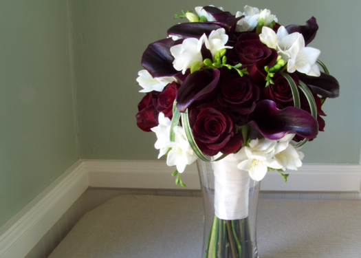 bridal bouquet with Black Baccara roses, Schwartzwalder mini callas, freesia and loops of lily grass