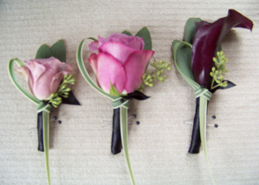 Avant Garde rose, Cool Water rose, and Schwartzwalder mini calla boutonnieres, all with seeded eucalyptus and lily grass accents