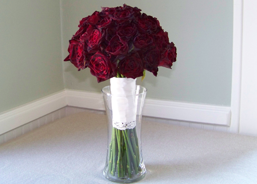 bridal bouquet of Black Baccara roses with lace detailing