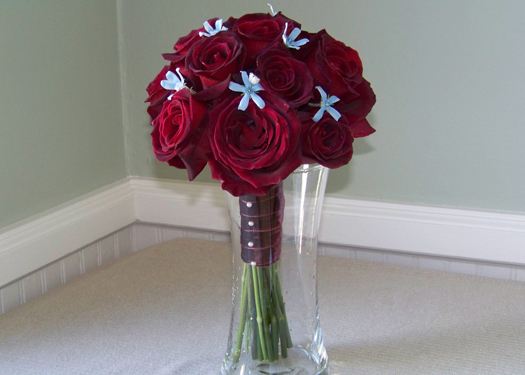 bridesmaid bouquet with Black Baccara roses, tweedia and a velvet stem wrap