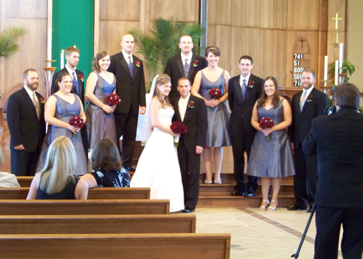 the bridal party in blue and red