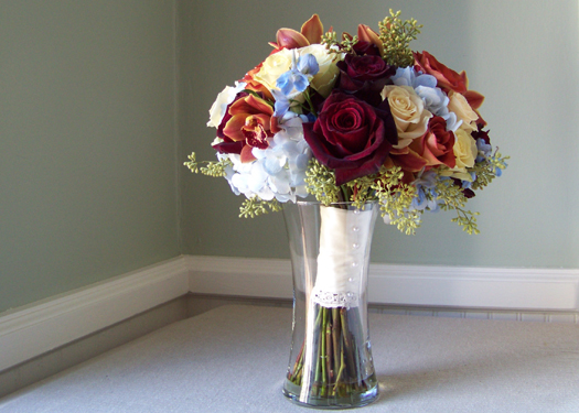 bridal bouquet with hydrangea, delphinium, cymbidium orchids, seeded eucalyptus, Black Baccara, Leonidas, and Cream Prophyta roses