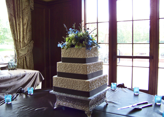 cake by the Sweet and Savory Bake Shop with a topper from Floral Verde LLC