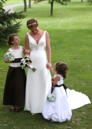 the bride with the junior bridesmaid and the flower girl
