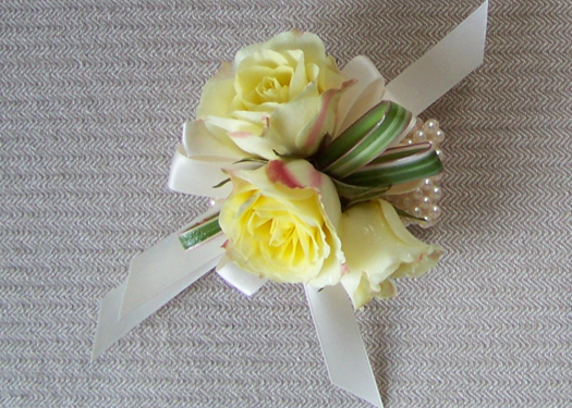 corsage with Lemoncello spray roses on an ivory pearl wristlet