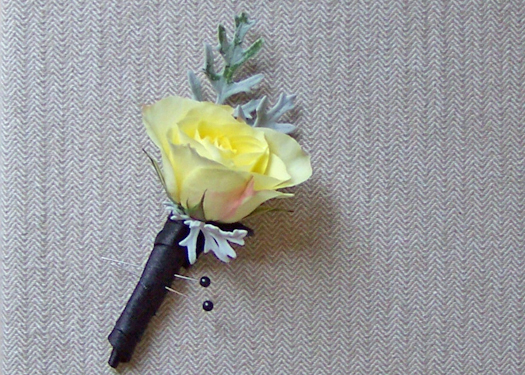 boutonniere with a single Lemoncello spray rose and dusty miller accents