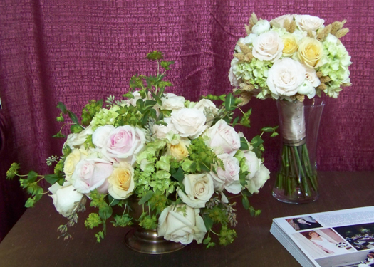 centerpiece and bouquet containing hydrangea, bupleurum, Cream Prophyta roses, Rosita Vendela roses, Sahara roses, Champagne sweetheart roses, ranunculus and dried phalaris