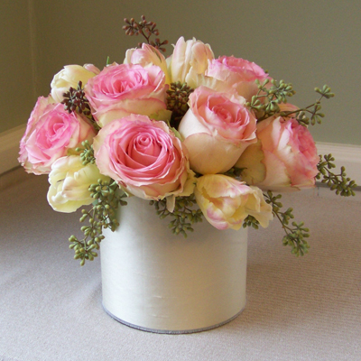 one dozen Esperance roses, parrot tulips, and seeded eucalyptus in a six inch cylinder vase wrapped with champagne silk