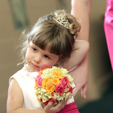 The flower girl pomander contains Twinkle Bride spray roses, Macarena spray roses, and green hydrangea