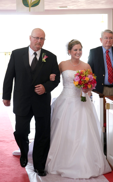 Ali and her father walk down the aisle