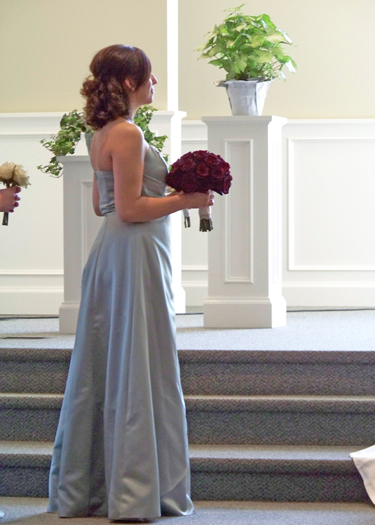 the maid of honor holding the bridal bouquet