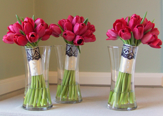 hand-tied bridesmaids bouquets with Ile de France tulips and a black lace accent