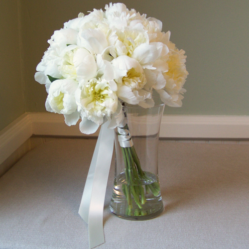 hand-tied white peony bridal bouquet with a satin ballet stem wrap