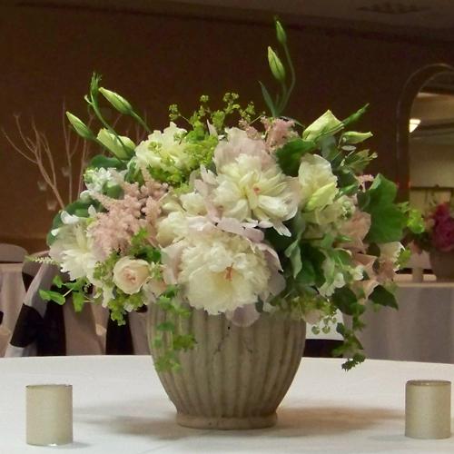garden centerpiece with peonies, lisianthus, astilbe, stock, Sweet Eskimo roses, White Mikado spray roses, scented geranium, bupleurum and alchemilla.