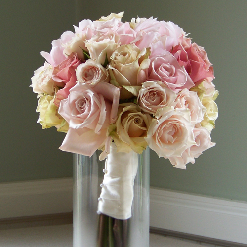 Bridesmaid bouquet with blush peonies, White Mikado spray roses, and three varieties of roses: Eos, Sweet Eskimo, and Sahara.