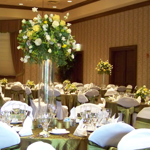 Tall centerpieces with rununculus, Skyline roses, Beach sweetheart roses, sweet peas, Green Fashion roses, Metallina roses, bupleurum and bonsai eucalyptus.