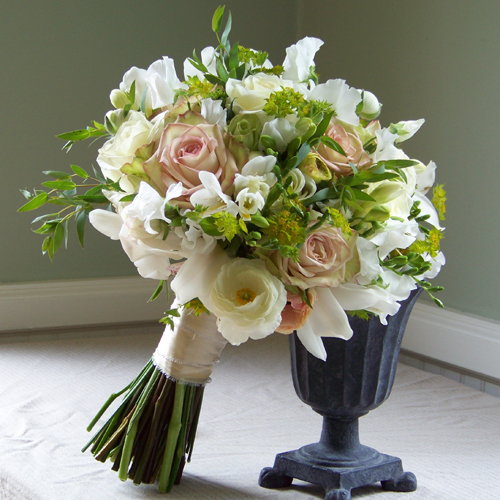 Hand-tied bridal bouquet with cymbidium orchids, sweet pea, freesia, Polar Star roses, ranunculus, Green Fashion roses, Green Tea roses, bupleurum and bonsai eucalyptus.